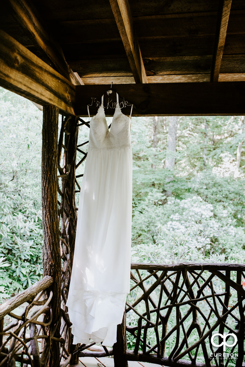 Wedding dress hanging on the porch.