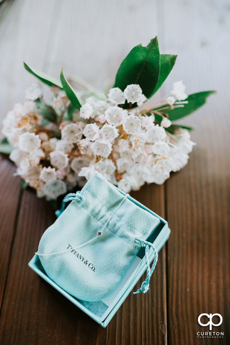 Tiffany and Co. bag and flowers.