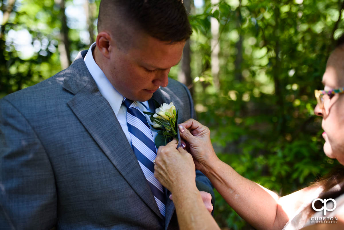 Groom getting his boutonnière on.