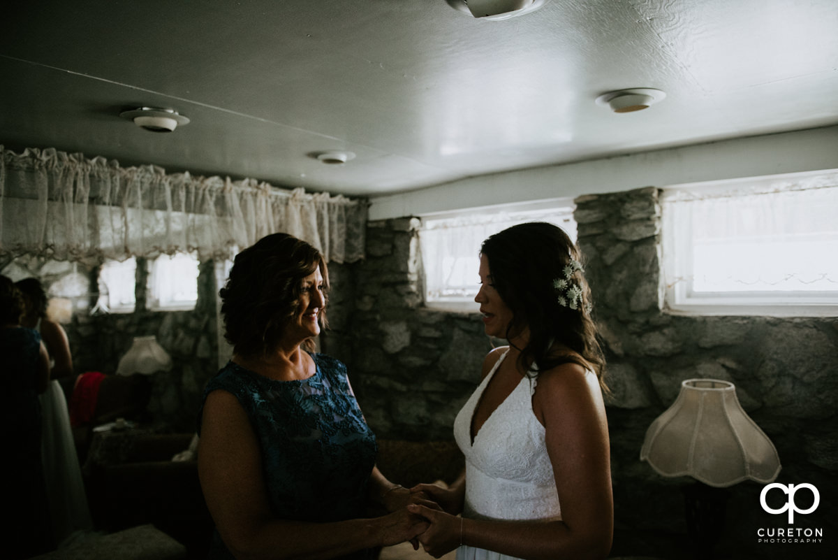 Bride and her mom sharing a moment before the ceremony.