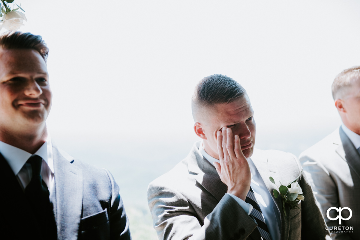 Groom tearing up as he sees his bride walking down the aisle at Pretty Place.