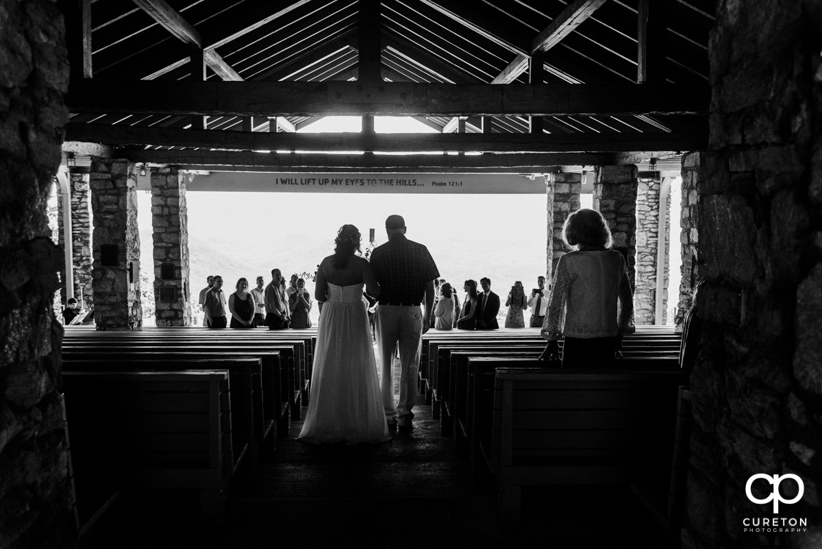 Bride and her father walking down the aisle at Pretty Place.