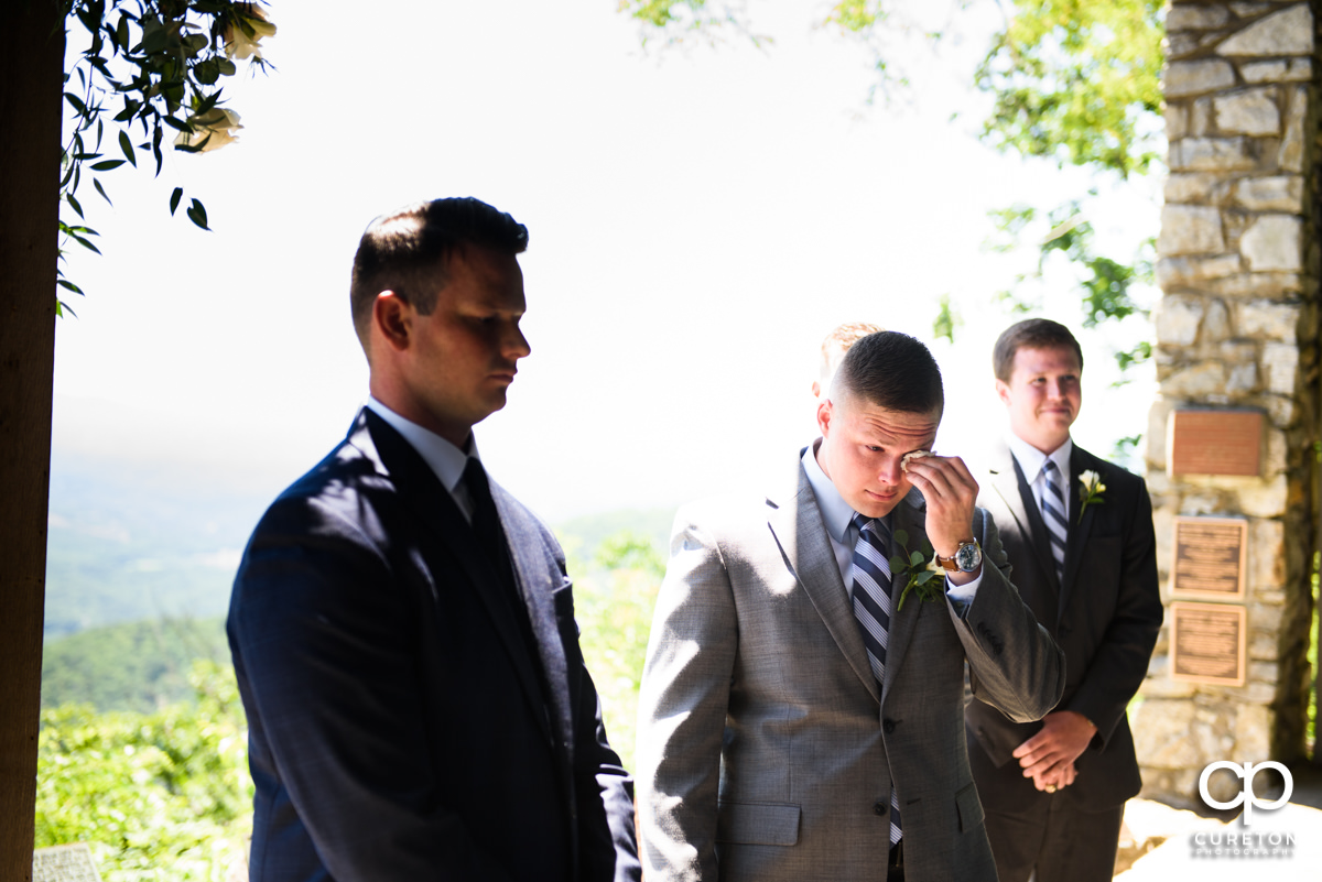 Groom getting emotional at his wedding at Symmes Chapel.