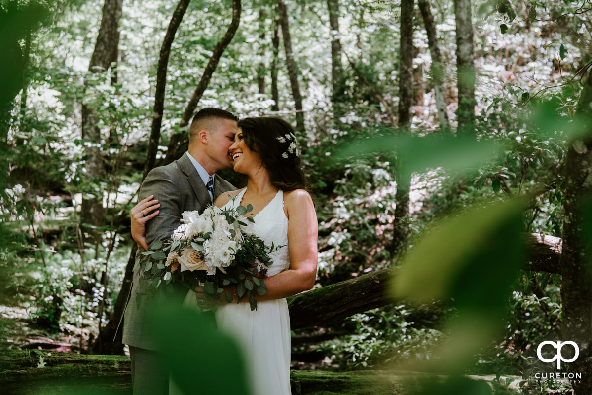 Bride and groom laughing in the woods after their South Carolina elopement wedding.
