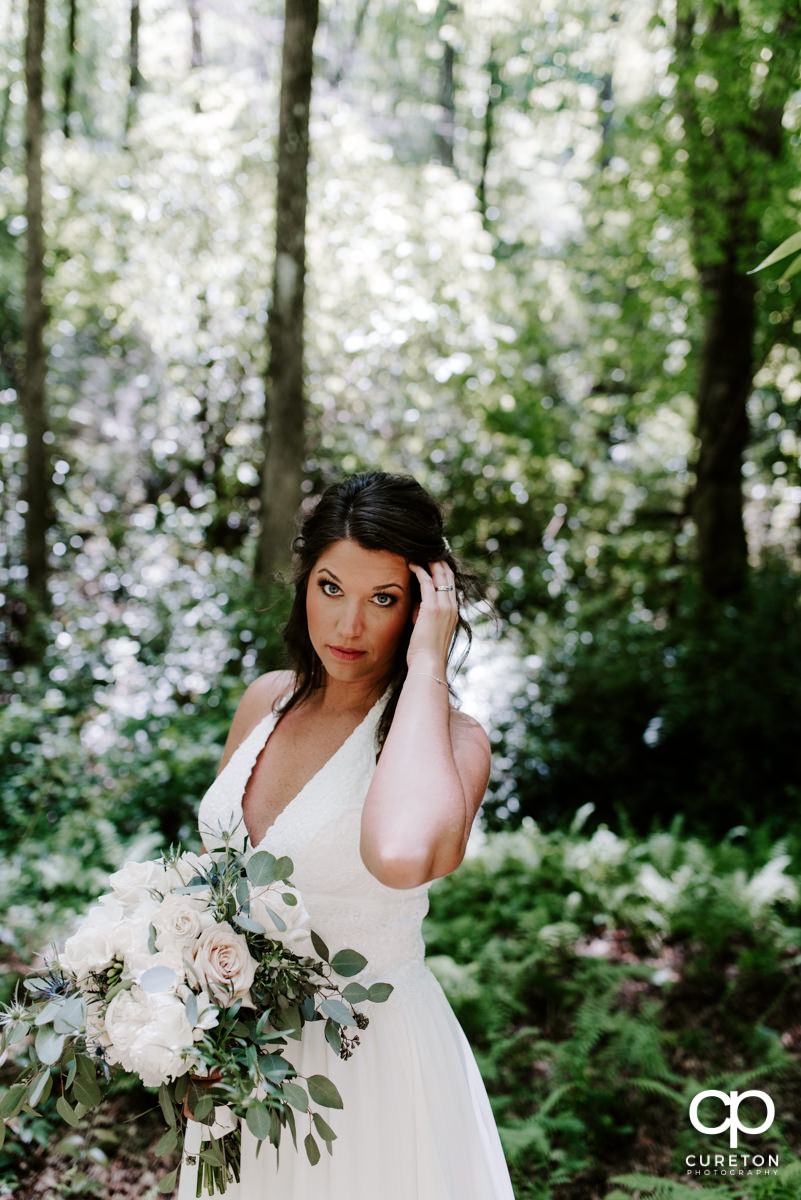 Bride in the forest after her elopement wedding outside of Greenville,SC.