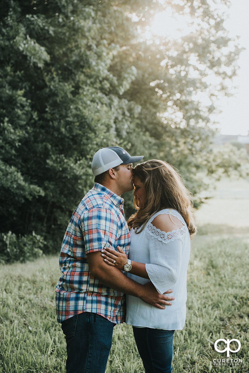 Engaged couple in a field during a Travelers Rest engagement session.
