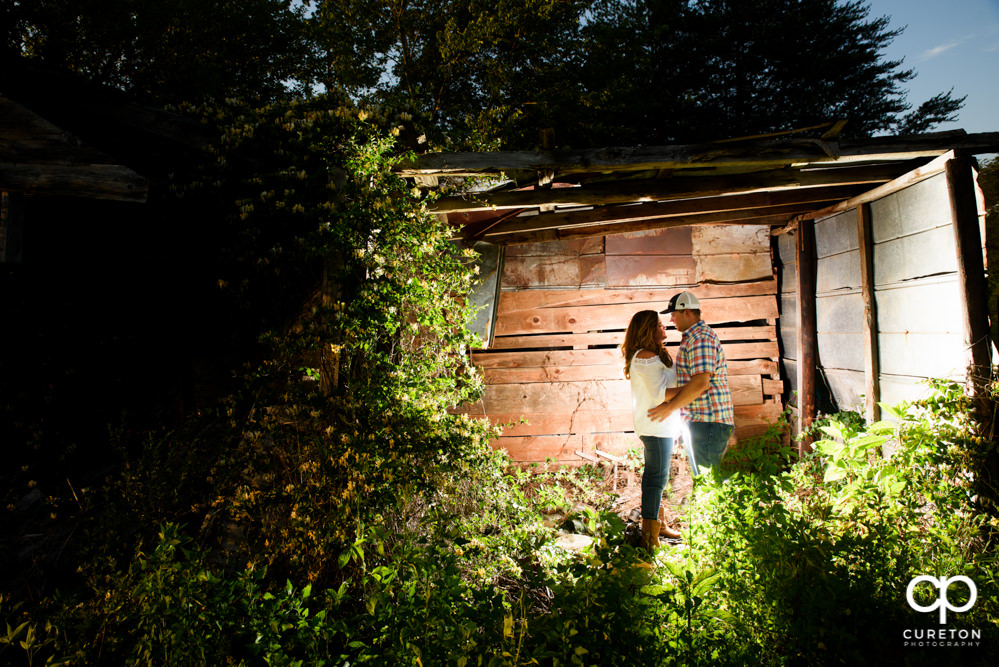Epic couple shot in a shed during a Travelers Rest engagement session.