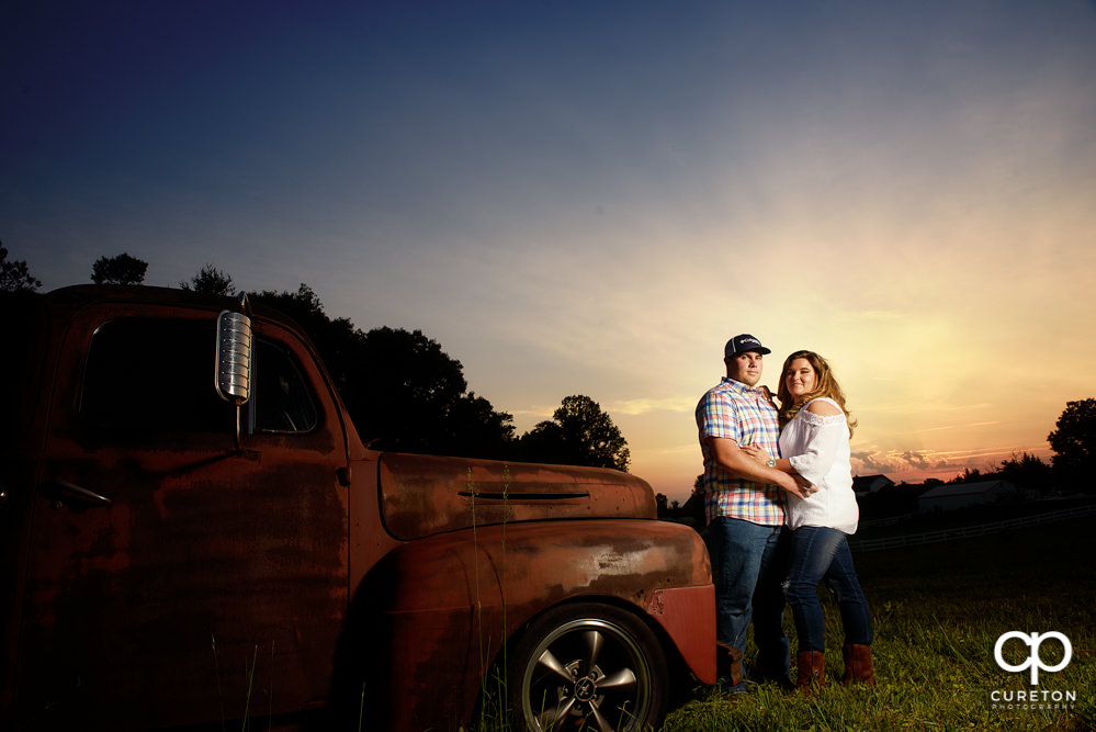Engaged couple at sunset in a field in Travelers Rest, SC.