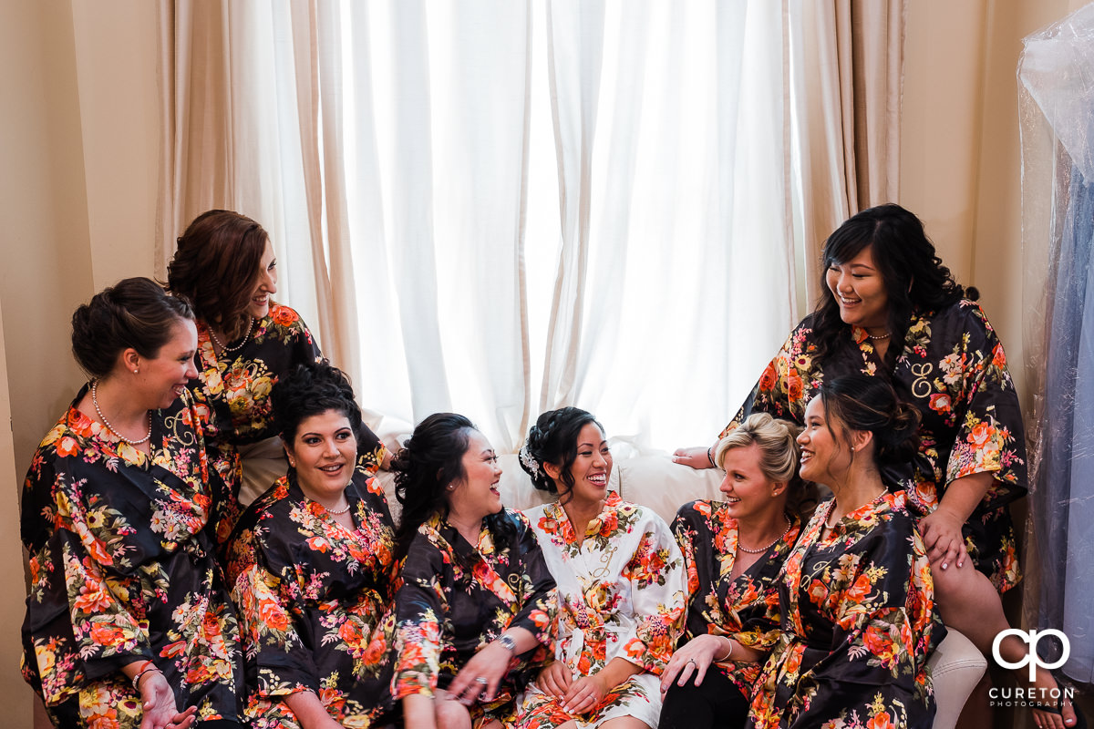 Bride and her bridesmaids in robes before the ceremony.