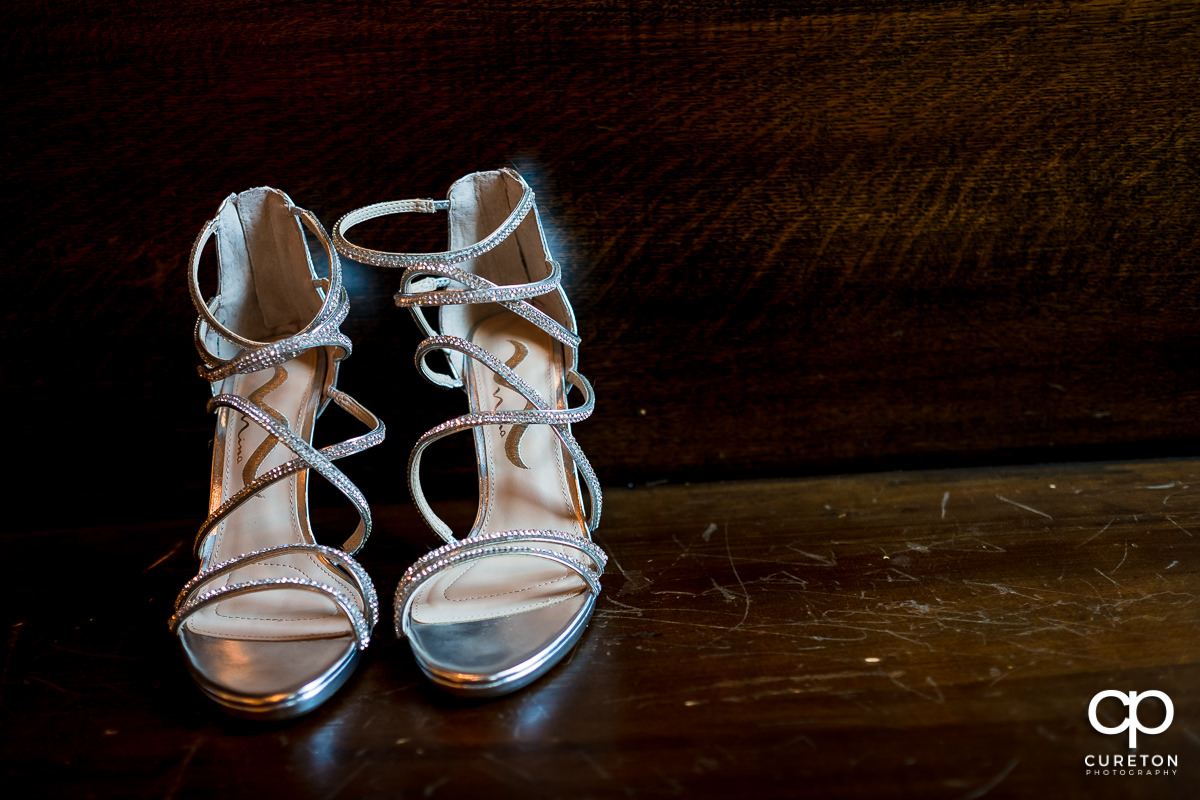 Bride's shoes on a pew.