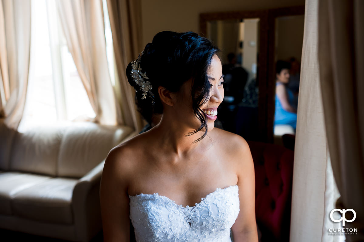 Bride looking out the window in the bridal suite at the Tybee Island Wedding Chapel.