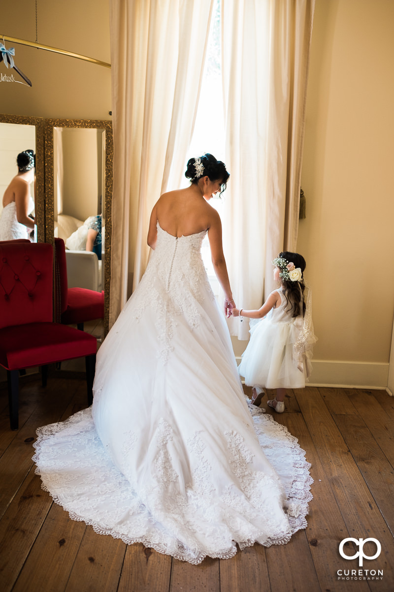 Bride and her flower girl sharing a moment before the wedding ceremony.