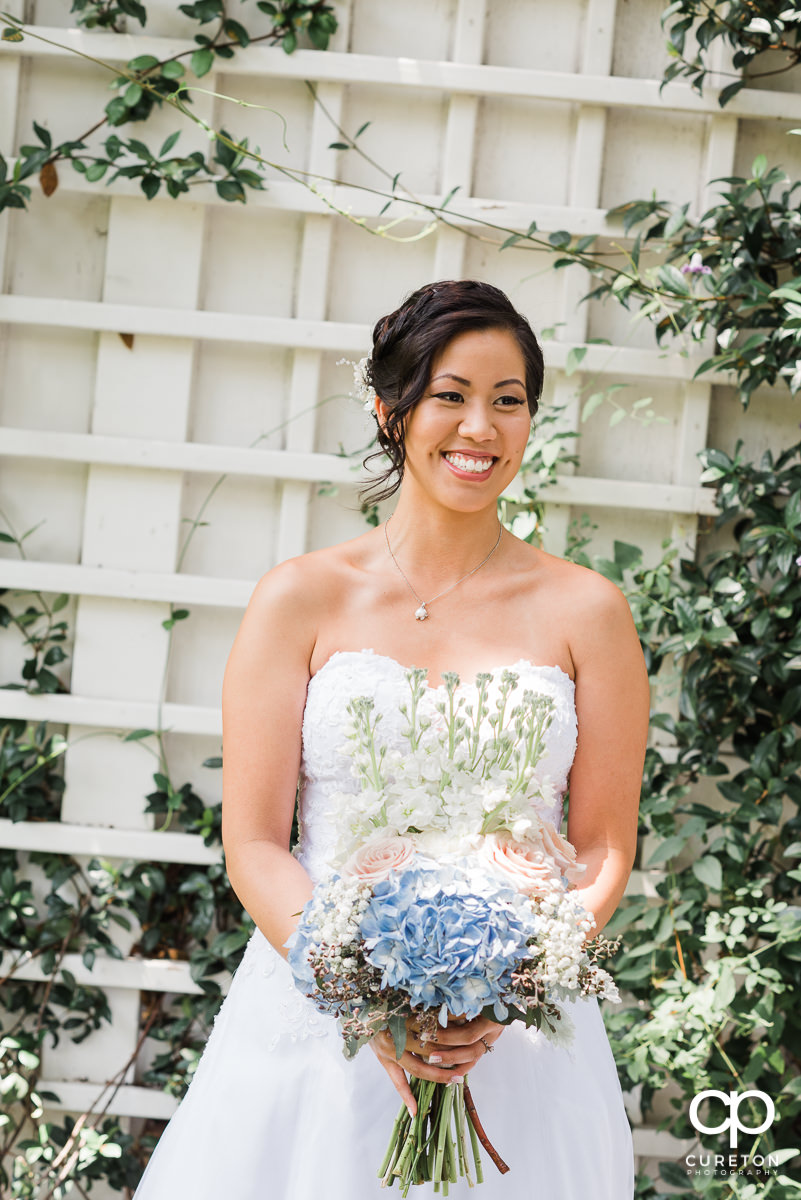 Beautiful bride standing outside the Tybee Island wedding chapel before her ceremony.