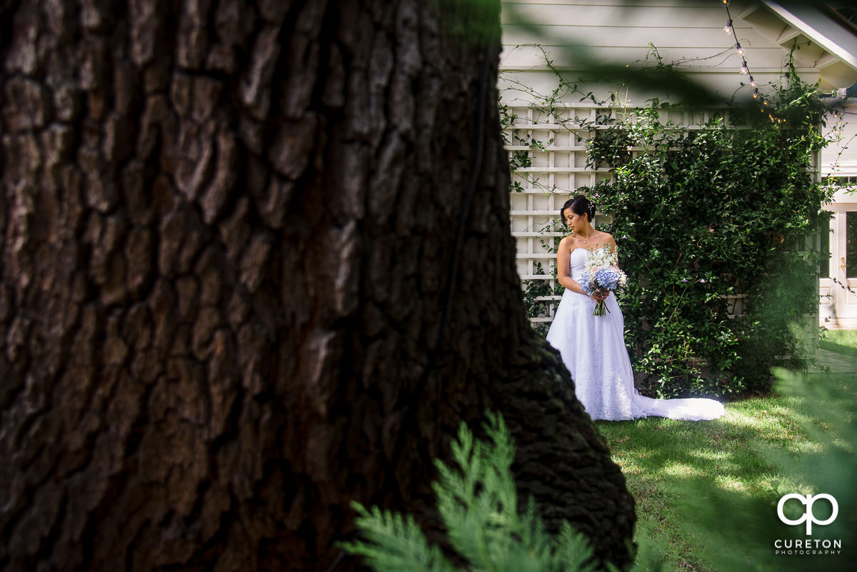 Bride looking at her dress outside the Tybee Island Wedding Chapel.