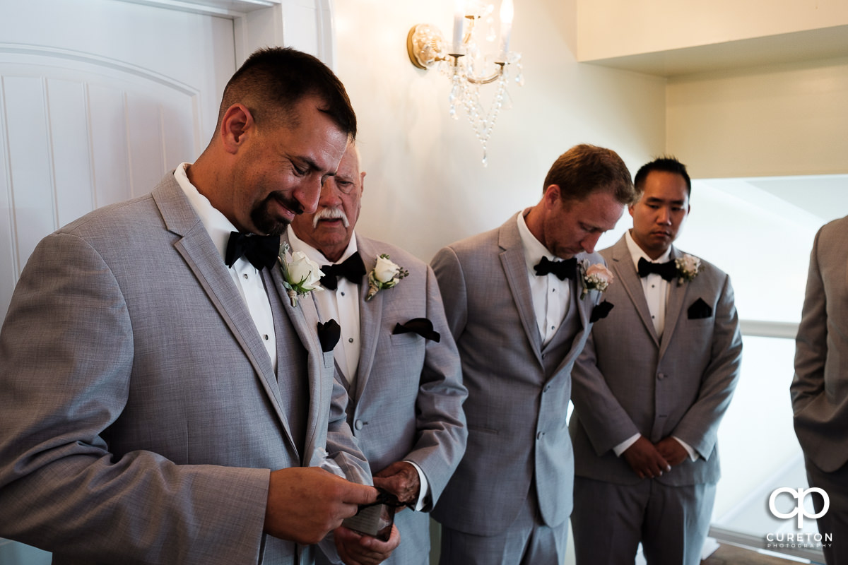 Groom receiving a gift before the wedding ceremony.