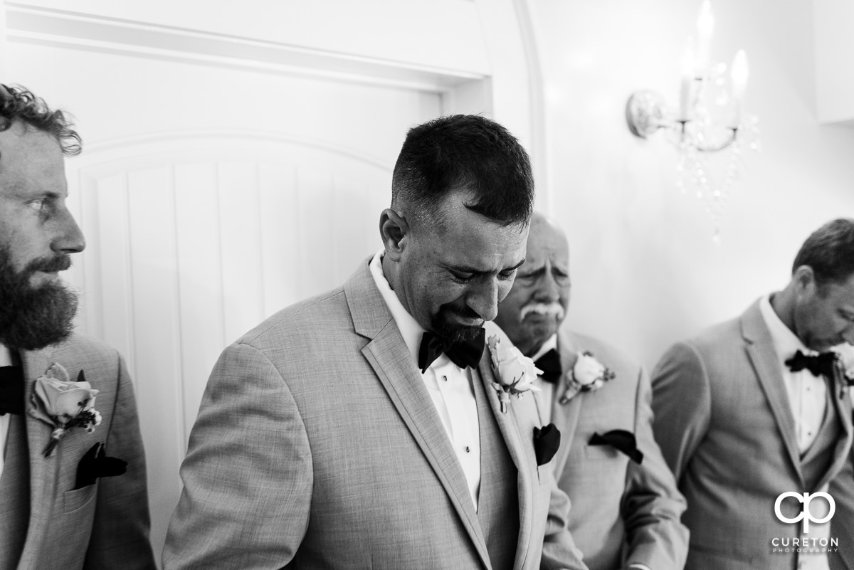 Groom getting emotional after receiving a gift before the wedding ceremony.