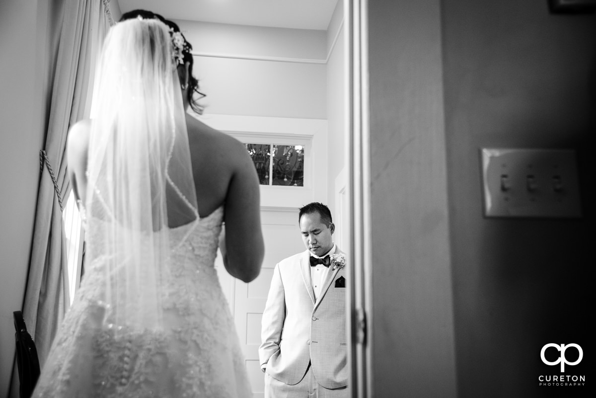 Bride having a first look with her brother.