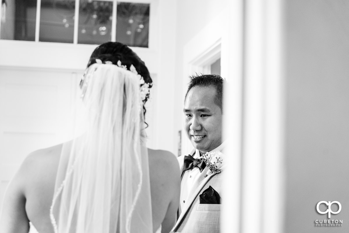 Bride's brother crying when he sees his sister in her dress for the first time.