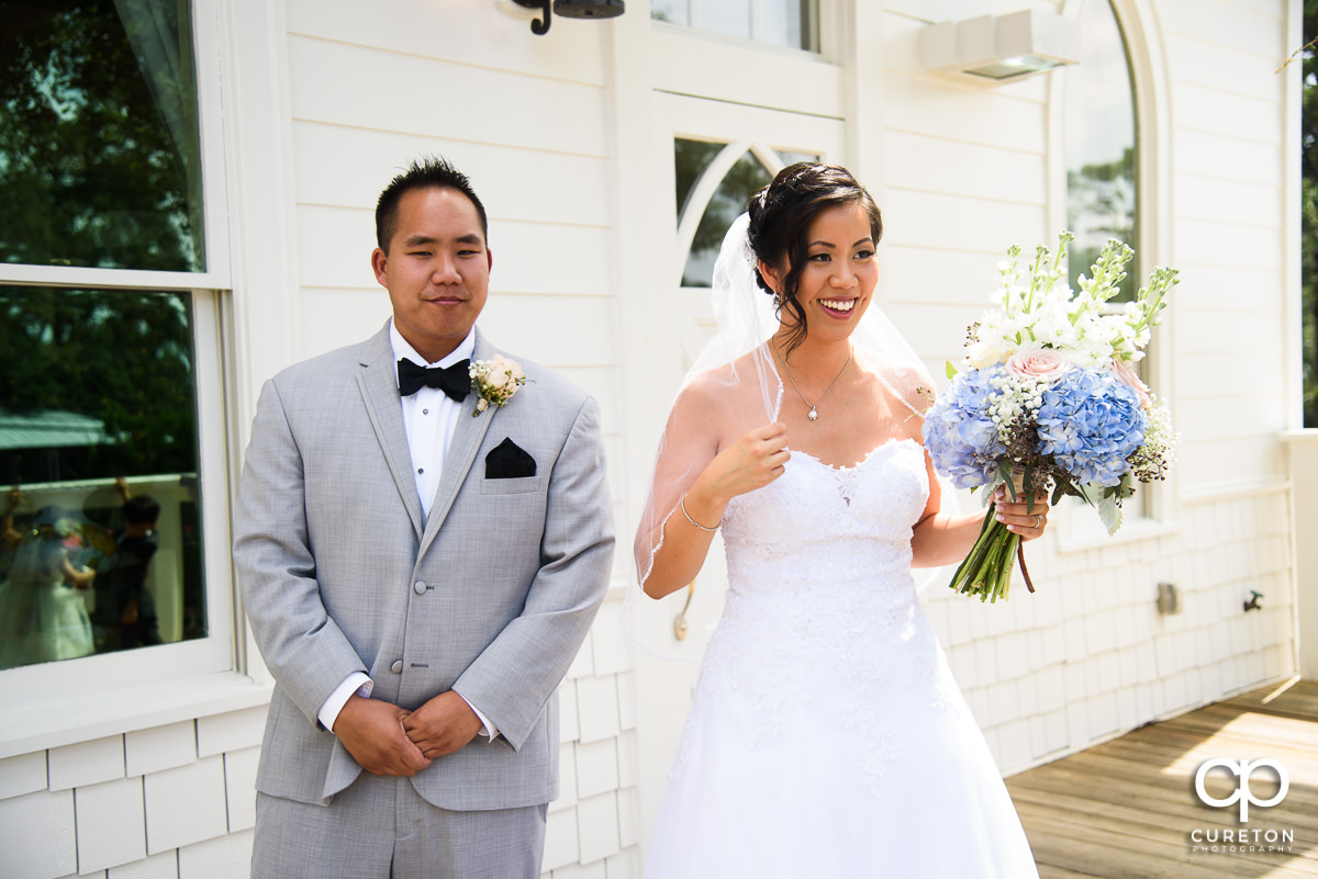 Bride and her brother outside the Tybee Island Wedding Chapel.