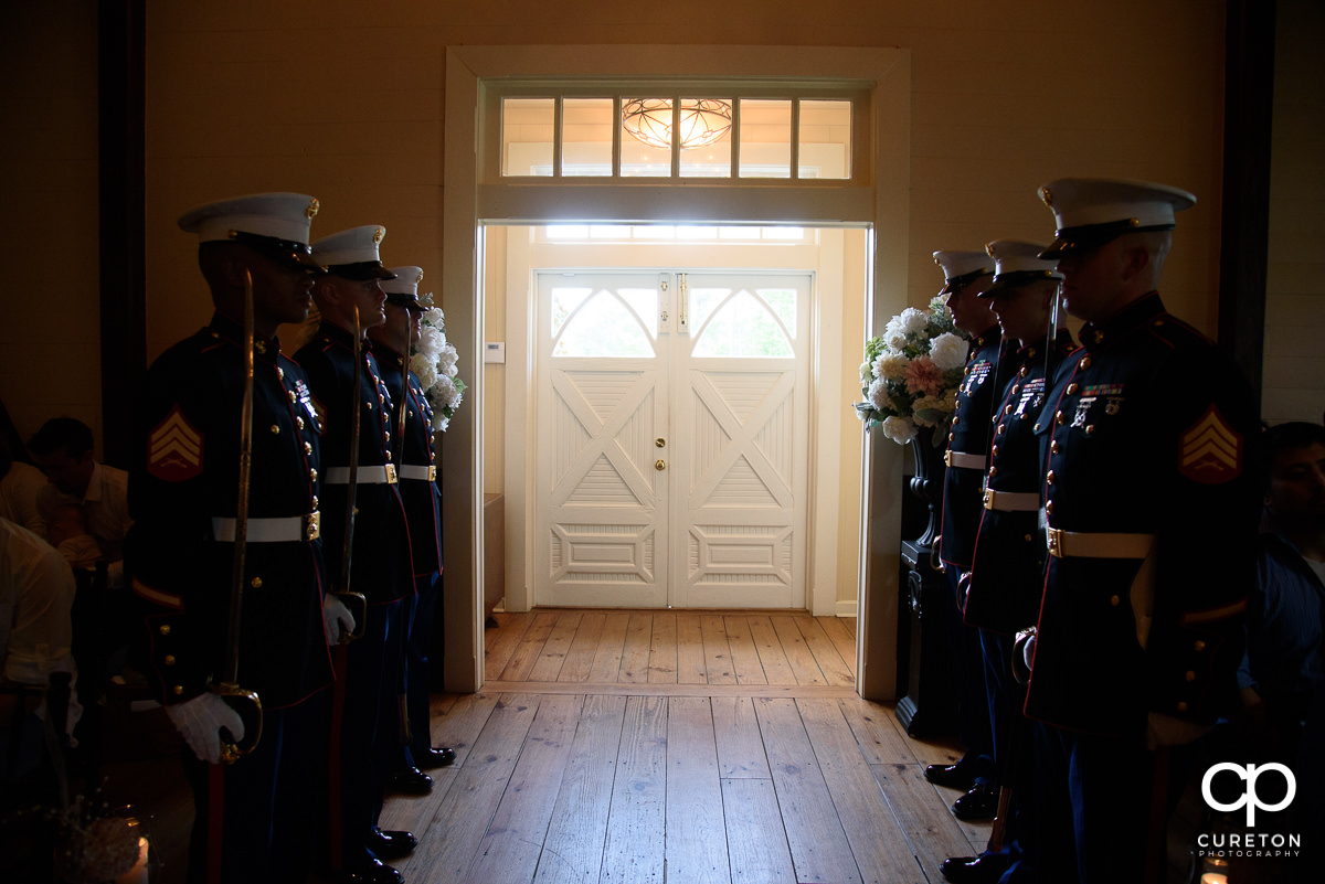 Marines lined up inside the wedding chapel.