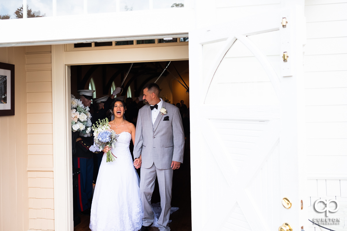 Bride and groom smiling leaving their Tybee Island wedding ceremony.