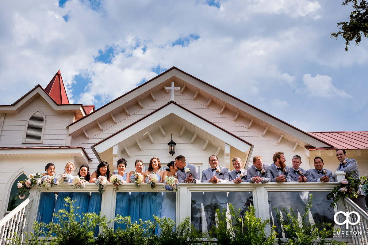 Bridal party standing on the deck outside the Tybee Island Wedding Chapel.