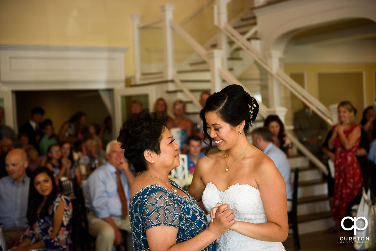 Bride and her mother sharing a dance at the wedding reception.
