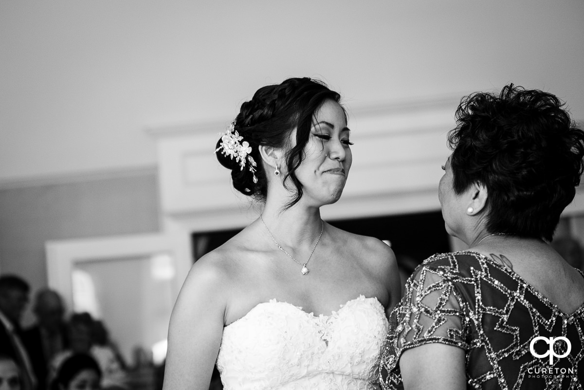 Bride tearing up during a dance with her mother at the wedding reception.