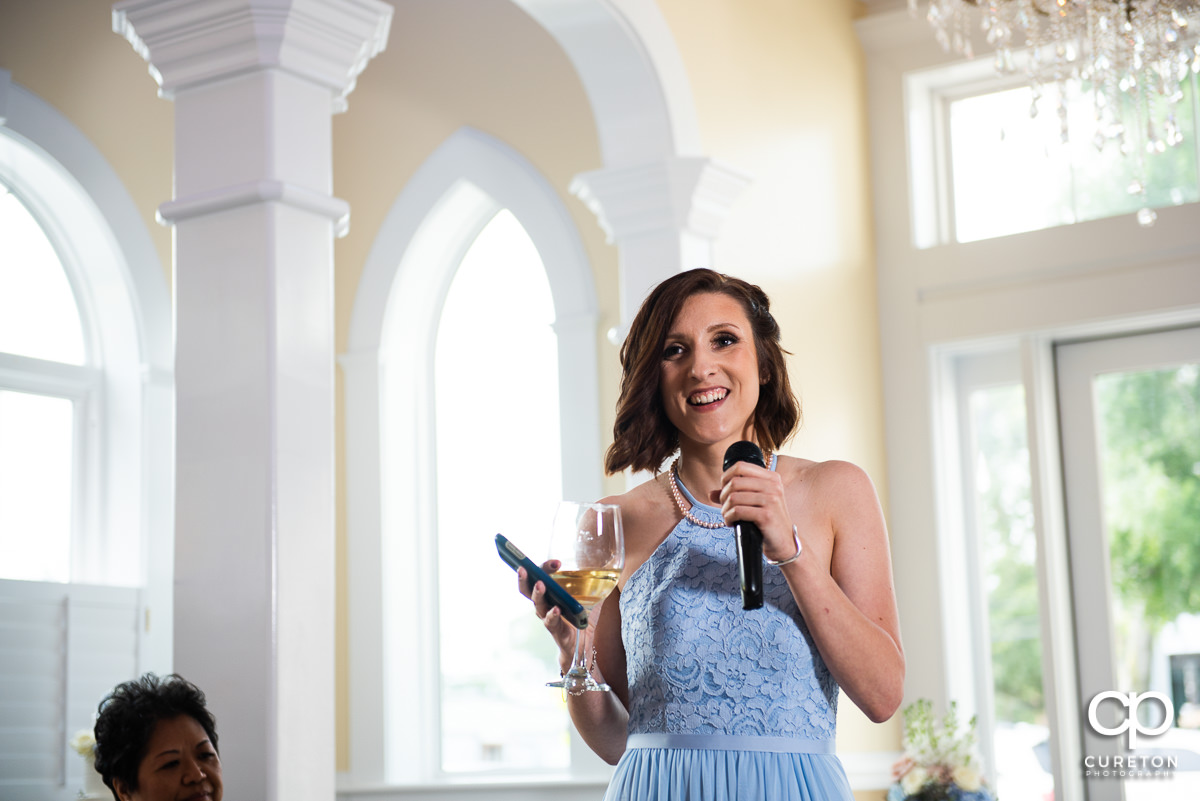 Maid of honor giving a toast.
