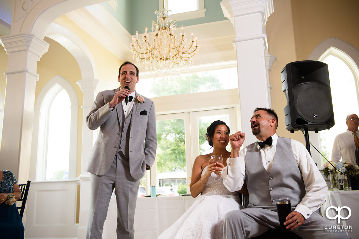 Groomsmen giving a toast during the reception.