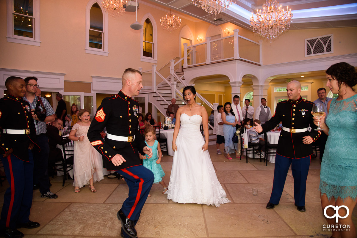 Marines line dancing at the reception.