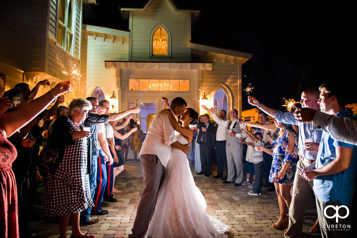 Bride and groom sparkler exit at the reception at the Tybee Island Wedding Chapel.
