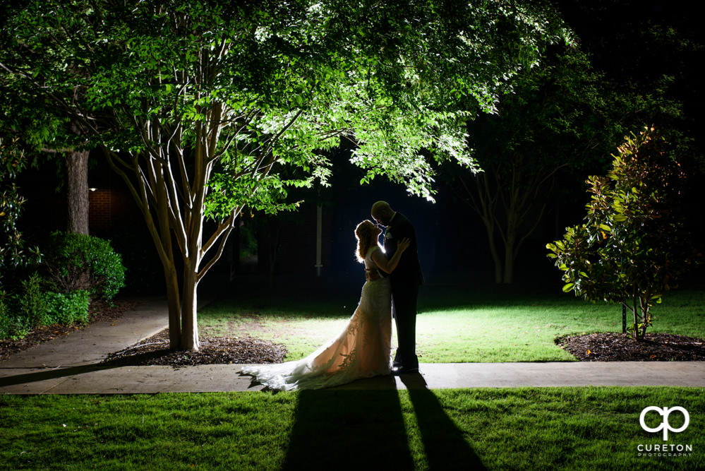 Bride and groom at sunset after their wedding at The Loom at Cotton Mill Place in Simpsonville,SC.