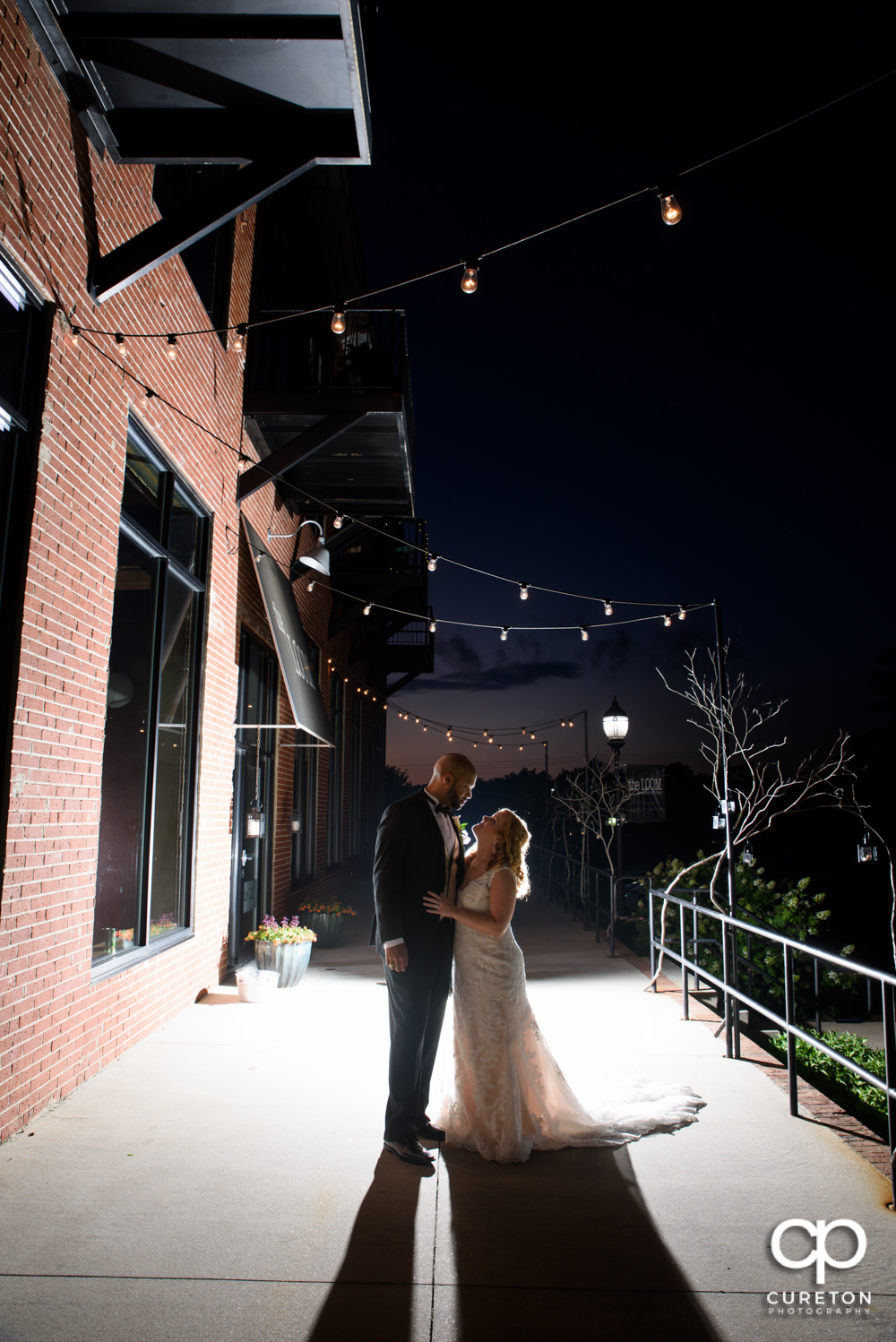 Bride and Groom after their wedding at The Loom at Cotton Mill Place in Simpsonville,SC.