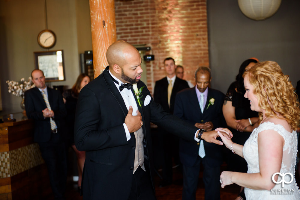 Bride and groom sharing their first dance at the wedding reception at The Loom.