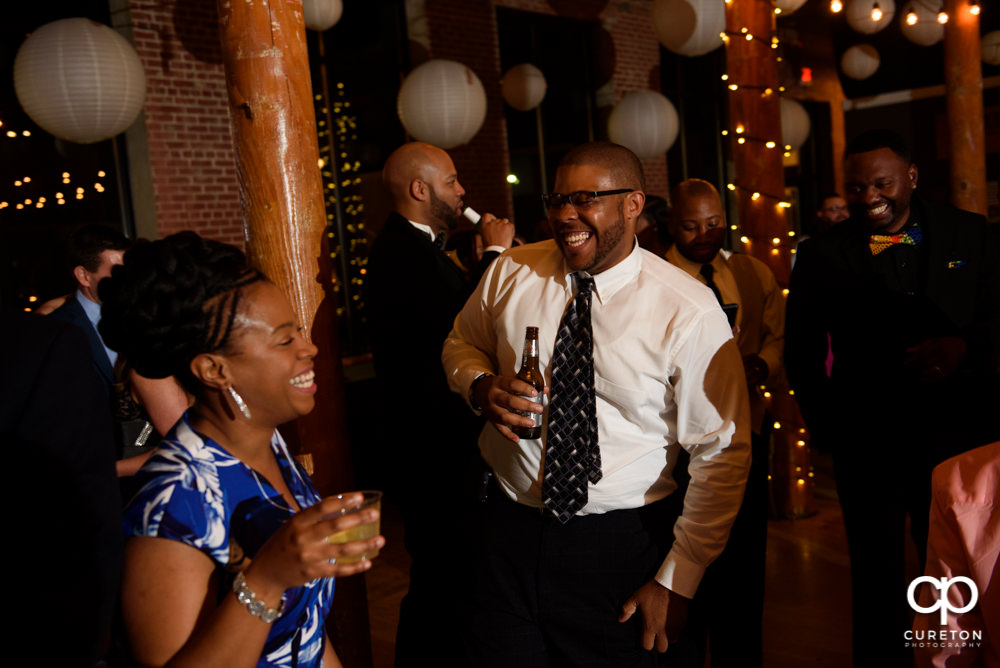 Wedding guests dance to the sounds of DJ Chris Scott.