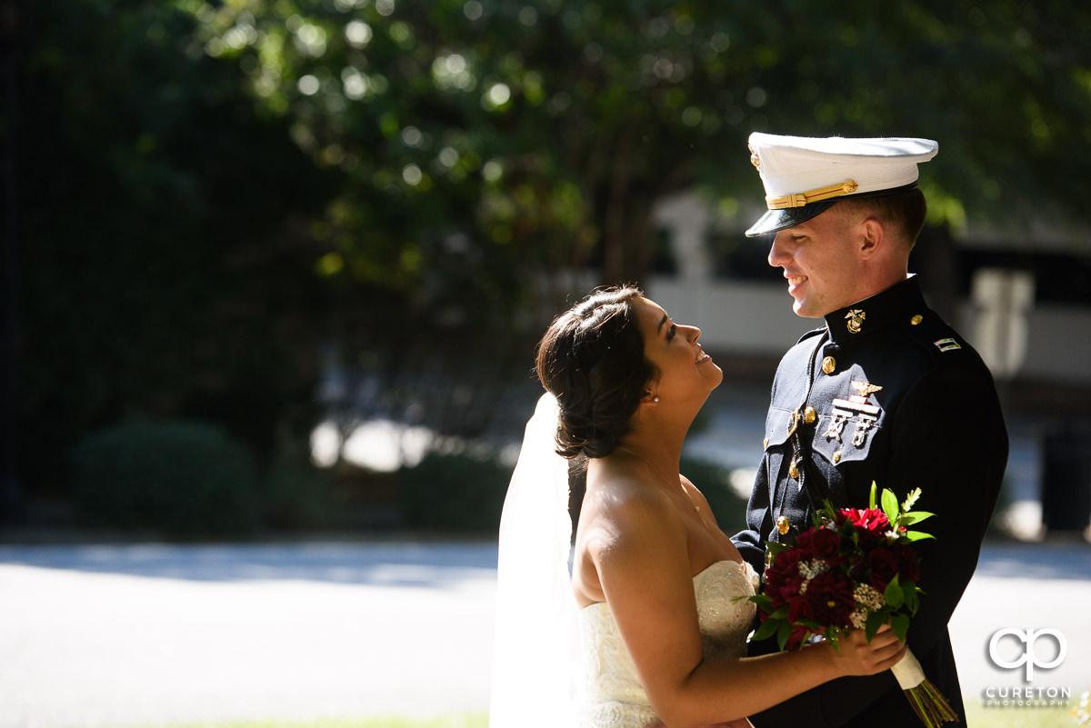Bride looking at her groom in full dress Marine uniform.