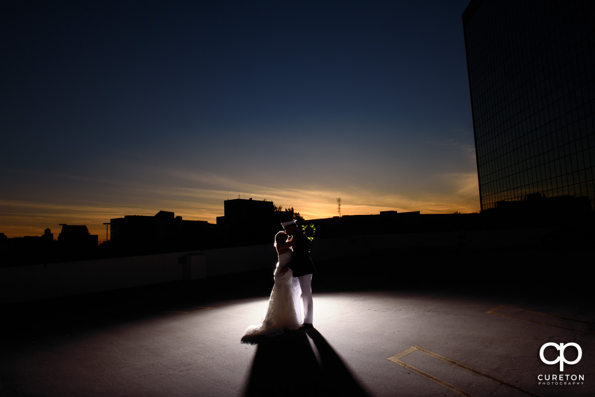 Bride and groom at sunset on a rooftop after their wedding ceremony at The Commerce Club in Greenville,SC.