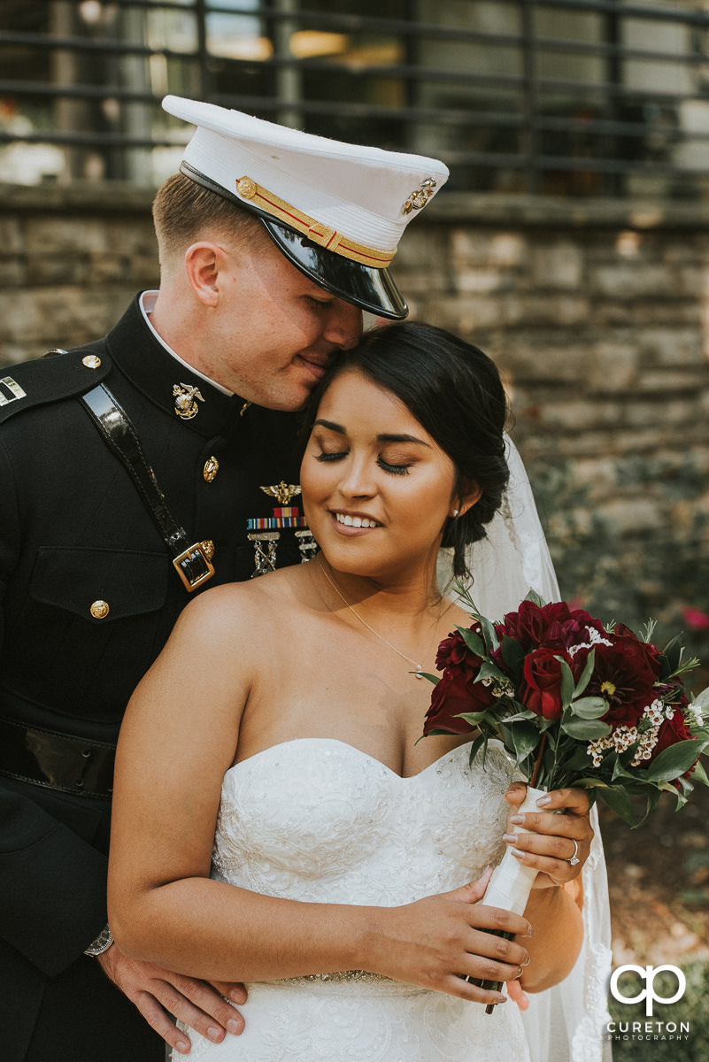 Marine groom and his bride snuggling before their wedding in Greenville,SC.