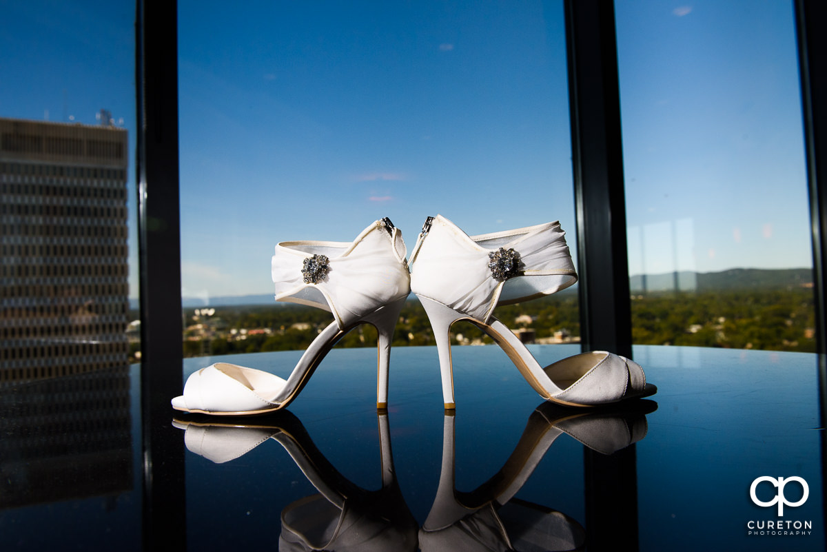 Bride's shoes with a skyline in the background.