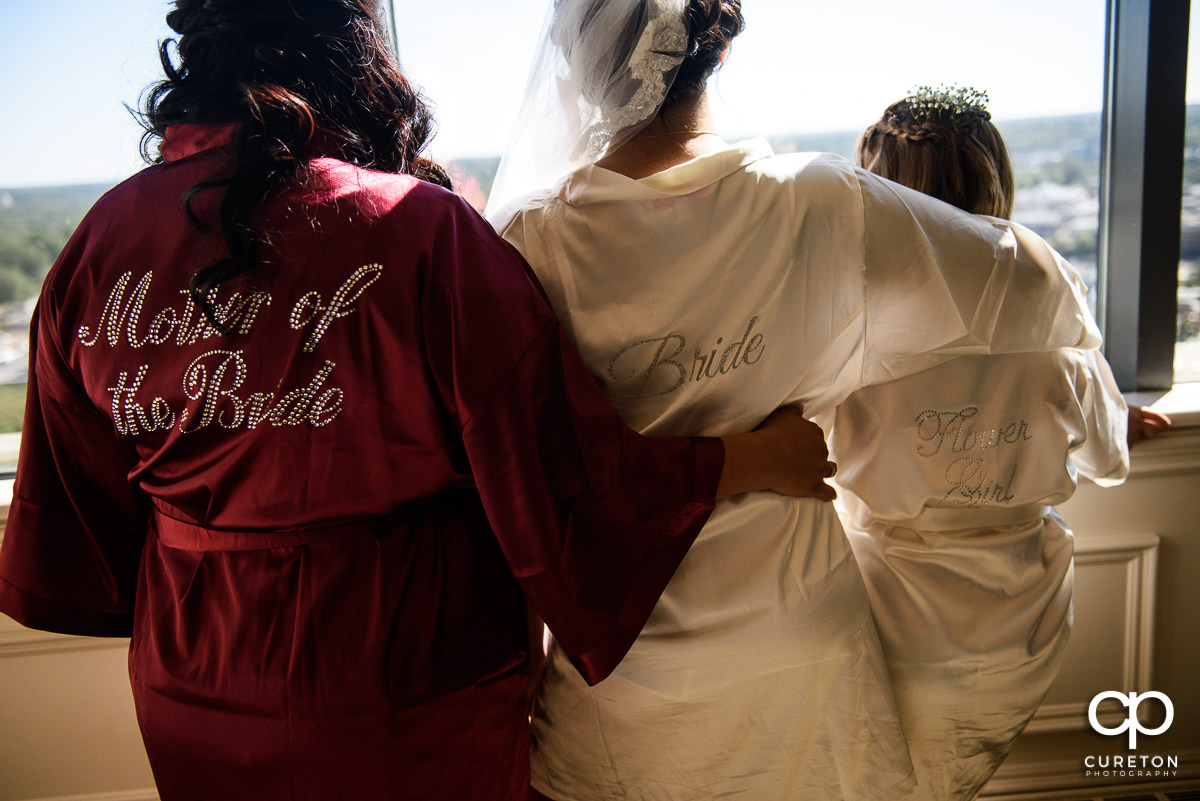 Bride and mother in robes.