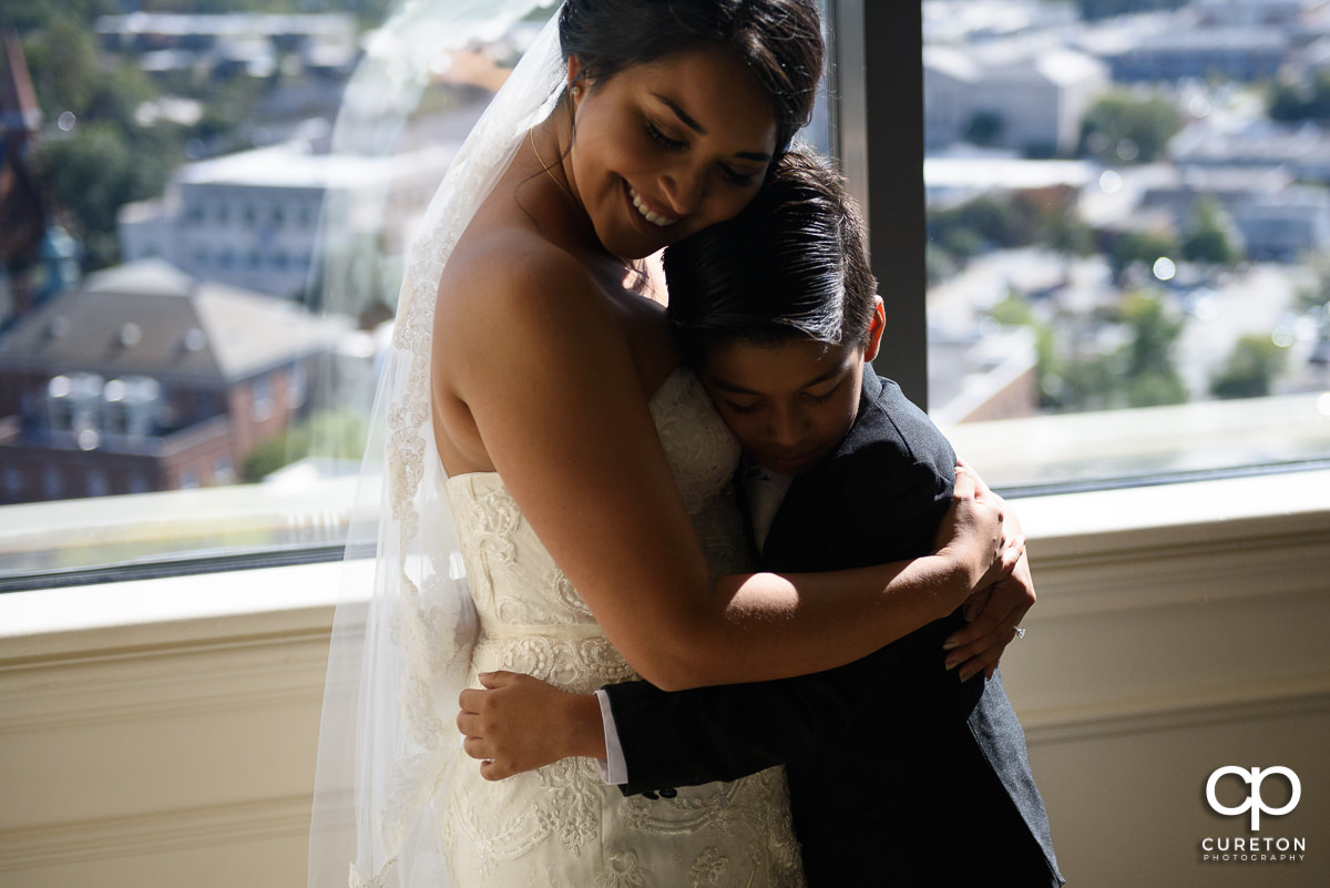 Bride hugging her son before the wedding.
