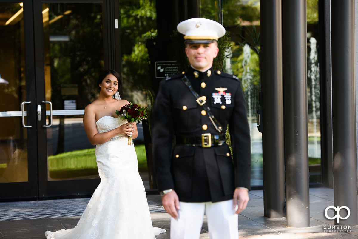 Bride and groom sharing a first look in front of The Commerce Club before the wedding.