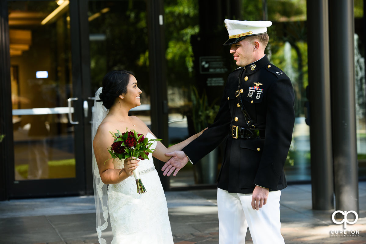 Bride and military groom first look.