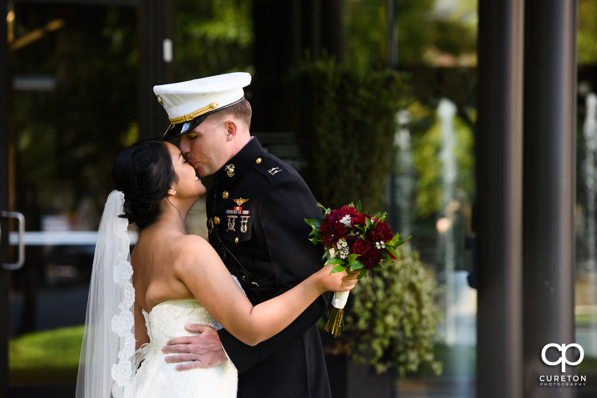 Groom in Marine dress uniform having a first look with his bride in downtown Greenville,SC.