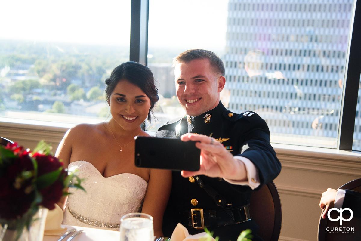 Bride and groom taking a selfie.