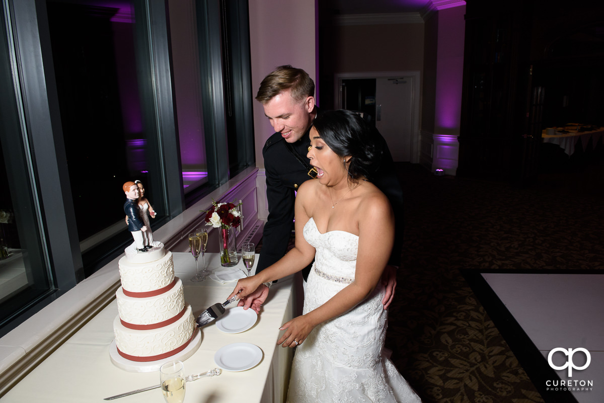 Bride and groom cutting the cake at the reception.
