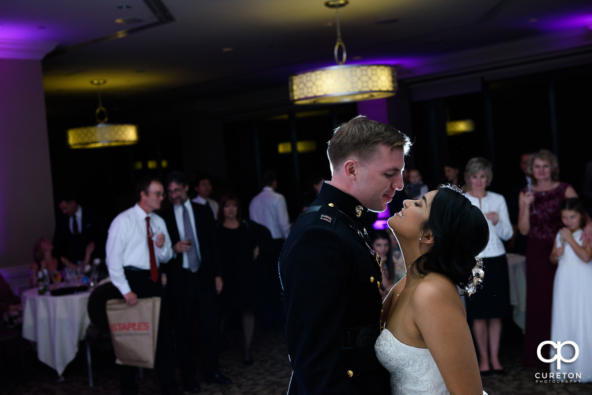 Bride and groom having a first dance at the wedding reception at the Commerce Club.
