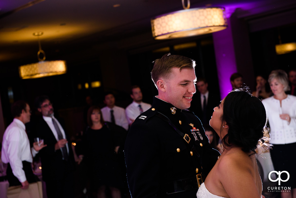 Groom smiling at his bride during their first dance.