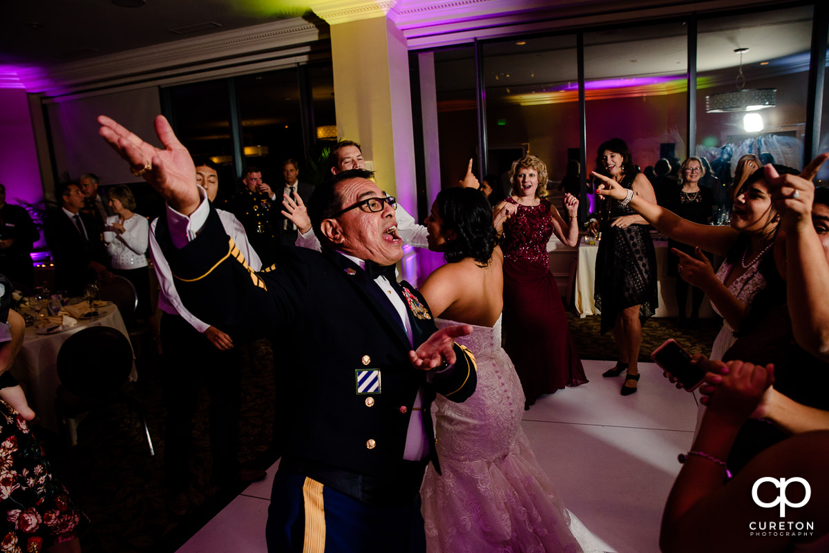 Bride's family on a packed dance floor at the Commerce Club wedding reception.